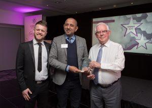 Dan Howard, Skills Forward presents Vretta with the Formative Award 2019