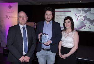 Graeme Clarke, SQA presents Qpercom with the Summative Award 2019